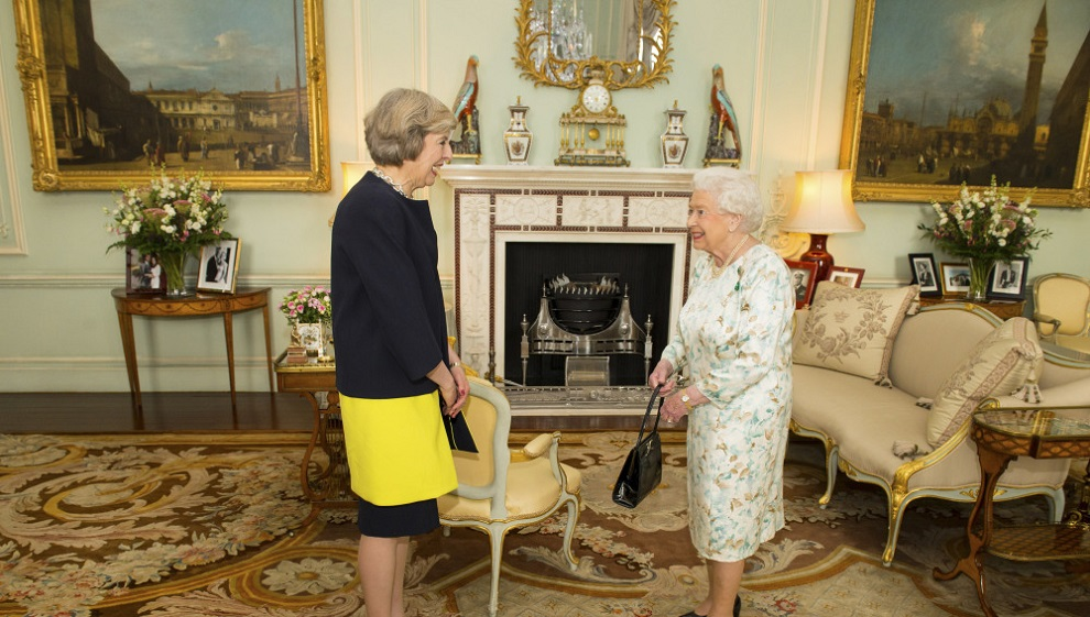 britain's queen elizabeth welcomes theresa may at the start of an audience in buckingham palace, where she invited her to become prime minister, in london