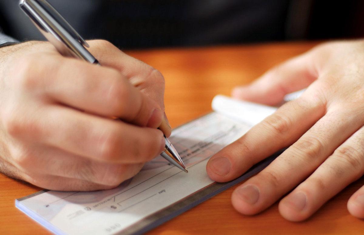 emision de cheques impuestos