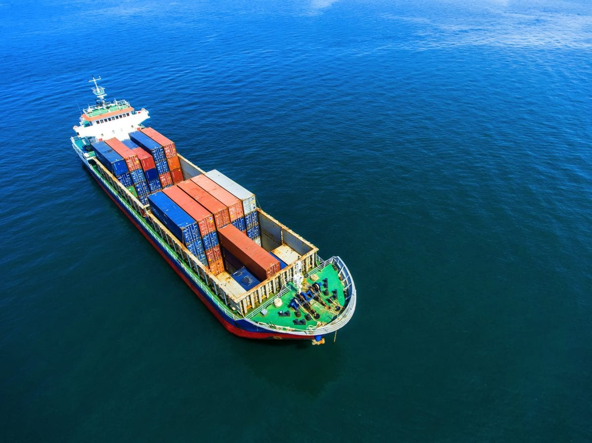 container ship in import export and business logistic.by crane ,