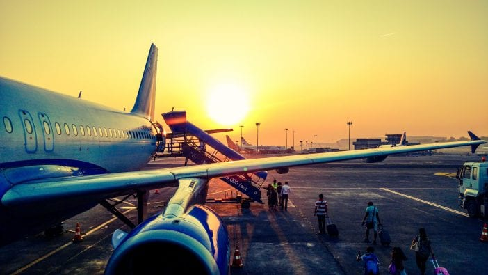 photography of airplane during sunrise 723240